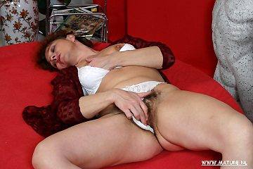 This big hairy pretty slut plays with a younger strapping man
