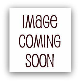 Stunning looking blonde posing in a pair of black seamed stockings