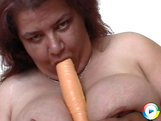 Help this fat bitch shove dildo's up her holes