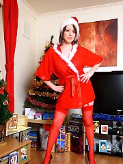 Busty Brit babe Jenny teases in santa suit and sexy fencenet stocking