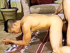 Hans Ebson stays on all fours as bodybuilder Randy Phillips pounds his t