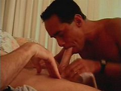 Horny gay hunks hardening and sucking dicks together on spanking a couch