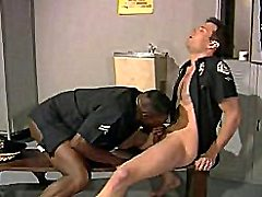 Black cop stuffing his mouth is full with ivory cop's hard cock