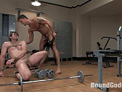Muscle stud gives a gym guy a bondage workout and a bondage fuck.