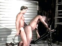 Horny retro black exercising his mouth on ivory cock shoved in the gym.