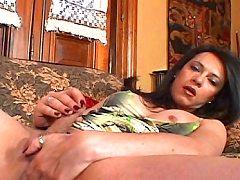 Hot dark hair tranny masturbating pussy on the couch till it cums!