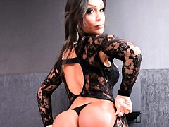 Latina she-male shows off her so nice tight body art and takes cock