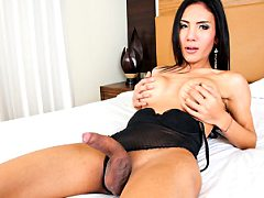 Beautiful Asian shemale strokes until her throbbing cock until she cums.