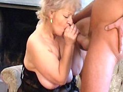 Granny loves the pleasure of young cock balls pounding in her mouth