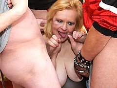 This sexy brunette mature nympho loves multiple throbbing dicks and cum