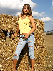 Hot brunette in jeans skirts stripping naked for the hay bales to pantyh
