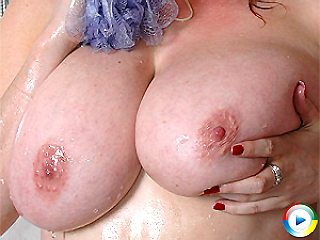 Lovely milf Lucy soaping up her massive juggs and moist cunt