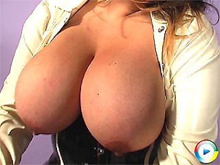 Brit babe Mellie D plays with all her juggs and fingers her bald cunt