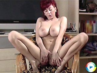 Krista playing with her juggs and fingering her gushing cunt