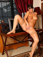 Secretary Lilly evans in glasses strips to her tan holdups for some offi