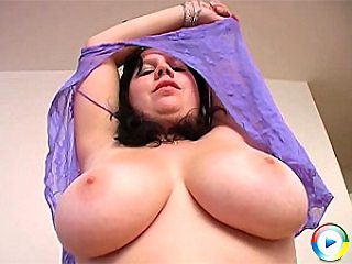 Ireen reveals her gigantic tits and rubbing her smooth pussy