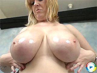 Davina playing wild with her huge melons and covering them in oil