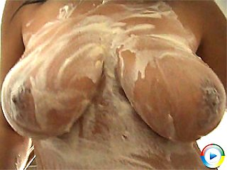 Rachela massaging her juggs and covers nipples in whipped cream
