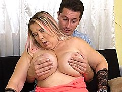 Huge breasted blonde mature lady doing her toy boy