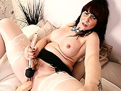 British housewife Toni Lace playing around with her toys nude in bed
