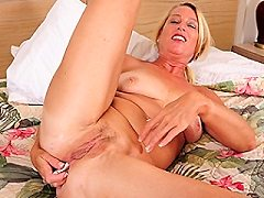 Naughty American housewife just loves playing hardcore with hot dildos a