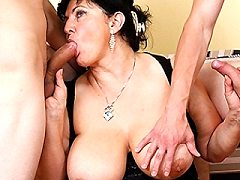 Big breasted blonde mature slut takes on two cocks