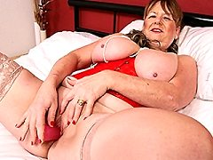 Naughty British mature business suit getting frisky