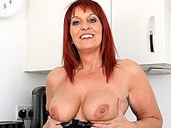 British Milf Beau Diamonds strips off her clothes and plays with her pus
