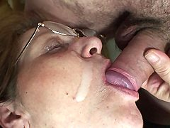 The old babe is taking two massive dicks at once as they are making her