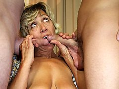 The young men fuck the granny, eat her pussy and let her suck their dick
