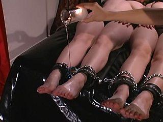 Asian mistress humiliates her lesbian slaves